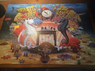 """Jacek Yerka, puzzle, """"Szachy na rafie""""."""